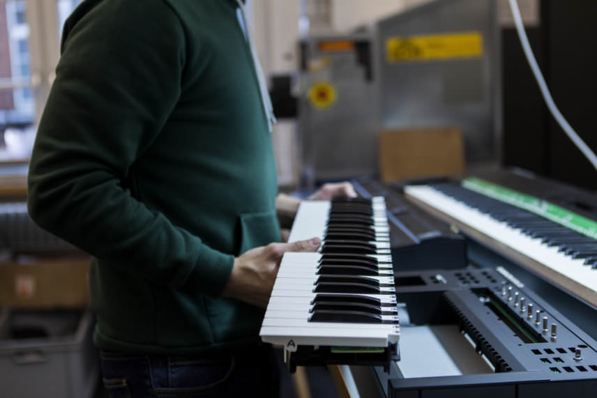 Engineer testing the internal workings of the Komplete Kontrol S keyboard